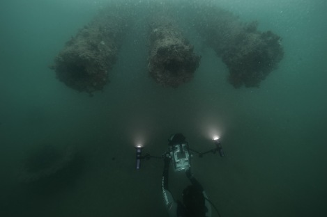 "NPS Diver Brett Seymour films the 14"" guns of turret #1 on the USS Arizona"